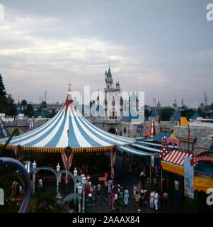 Vintage September 1972 photograph, merry-go-round and Cinderella's Castle in Fantasyland at Disneyland theme park in Anaheim, California. SOURCE: ORIGINAL 35mm TRANSPARENCY - Stock Photo