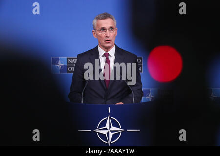 Brussels, Belgium. 20th Nov, 2019. NATO Secretary General Jens Stoltenberg speaks at a press conference after the meeting of the North Atlantic Council at the level of foreign ministers at the NATO headquarters in Brussels, Belgium, on Nov. 20, 2019. Foreign ministers of the North Atlantic Treaty Organization (NATO) agreed to include space as its new operational domain alongside air, land, sea and cyber, NATO Secretary General Jens Stoltenberg said Wednesday. Credit: Zheng Huansong/Xinhua/Alamy Live News - Stock Photo