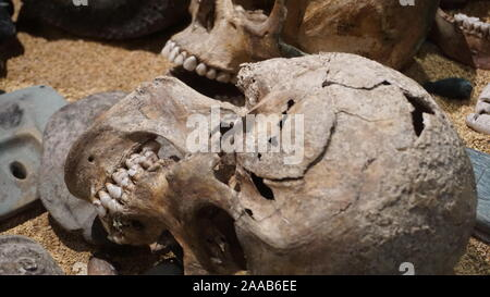 Skulls at Templo Mayor, from Aztec sacrifical victims excavated at this archeological site in Zócalo, Mexico City. - Stock Photo