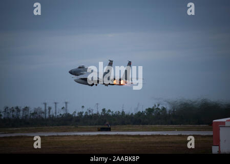 An F-15 Eagle from the 123rd Fighter Squadron, Portland Air National Guard Base, Ore. takes off during Checkered Flag, November 14, 2019, Tyndall Air Force Base, Fla. Checkered Flag is a multi-airframe, joint-service exercise which enables pilots to carry out complex air-to-air combat scenarios. (U.S. Air National Guard photo by Tech. Sgt. Steph Sawyer, 142nd Fighter Wing Public Affairs) - Stock Photo
