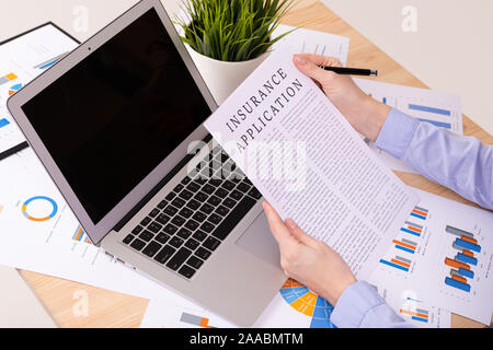 insurance applecation concept, documents on the desktop - Stock Photo
