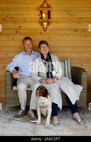 Lady Delia Thornton, with her husband Air Marshal(Retired) Sir Barry in the garden of their home near Cirencester. - Stock Photo