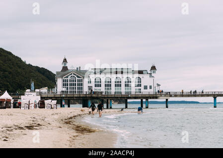 Famous Sellin Seebruecke,Sellin Pier, a cloudy day of summer, Ostseebad Sellin tourist resort, Baltic Sea region, Germany - Stock Photo