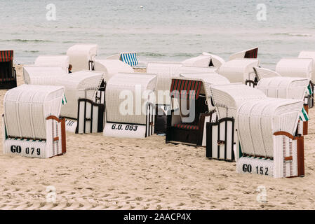 Hooded beach chairs in Baltic sea beach a cloudy day of Summer. Sellin, Rugen Island. Germany - Stock Photo