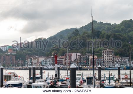 Little boats in the harbor by the quiet bay in northern Spain - Stock Photo