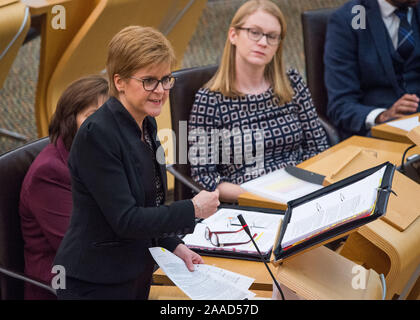Edinburgh, UK. 21st Nov, 2019. Pictured: (left) Nicola Sturgeon MSP - First Minister of Scotland and Leader of the Scottish National Party (SNP); (right, Shirley-Anne Somerville MSP. Scenes from the weekly session of First Ministers Questions in the Scottish Parliament. Credit: Colin Fisher/Alamy Live News - Stock Photo
