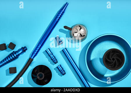 Top view of Hookah parts on light blue background - Stock Photo