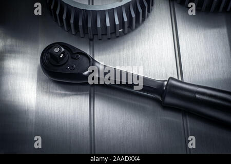 Reinforced professional black matt hex wrench placed on a polished aluminum surface. View from the top. - Stock Photo