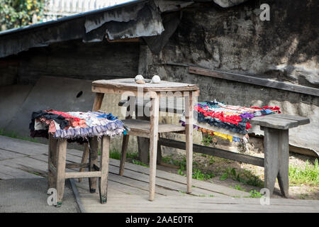 Location for the set in the village: table and chairs, scenery for the film - Stock Photo