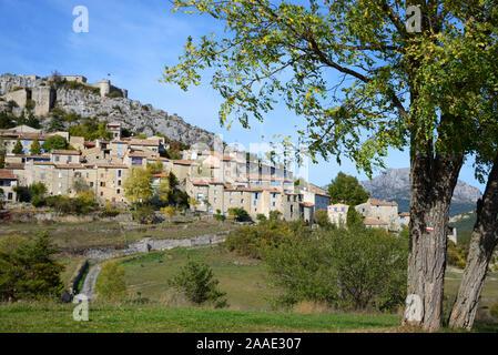 View of Historic Village of Trigance, framed by tree, near the Verdon Gorge, Parc Naturel Régional du Verdon, Var Provence France - Stock Photo
