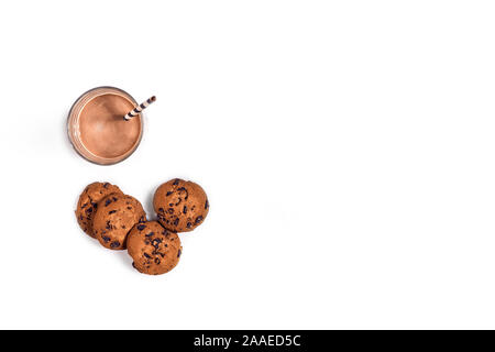 Glass of chocolate milk with oat cookies on white background. Top view - Stock Photo