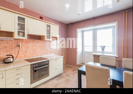 Russia, Moscow- July 06, 2019: interior room apartment. standard repair decoration in hostel. kitchen and dining room - Stock Photo