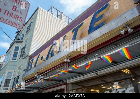 Facade with original art deco style sign at the iconic Bi Rite 18th Street Market, originally opened in 1940, in the Mission District of San Francisco, California, with string of rainbow LGBT pride flags, July 18, 2019. () - Stock Photo
