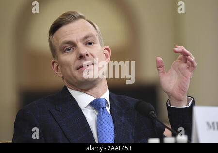 Washington, United States. 21st Nov, 2019. David Holmes, a U.S. Embassy official in Ukraine, mimics the way Ambassador Gordon Sondland held his cell phone away from his ear during a call with President Donald Trump at a restaurant in Kiev, as he testifies before the House Intelligence Committee Impeachment Hearing on Capitol Hill in Washington, DC, on Thursday, November 21, 2019. Credit: UPI/Alamy Live News - Stock Photo