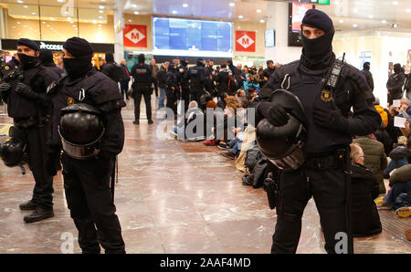 Barcelona / Spain - November 16, 2019: Catalan police Mossos desquadra check tickets of passengers entering the high speed rails in Sants station in B - Stock Photo