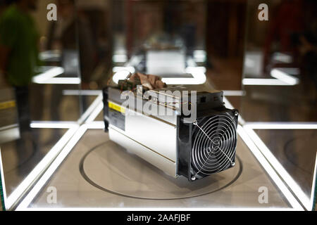 Cryptocurrency mining equipment - ASIC - application specific integrated circuit on farm stand at expo - Stock Photo