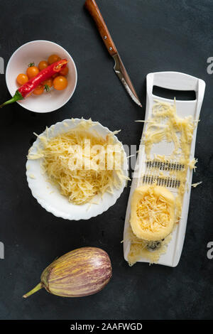 process of making and cooking the cut zucchini pasta spaghetti on the tables - Stock Photo