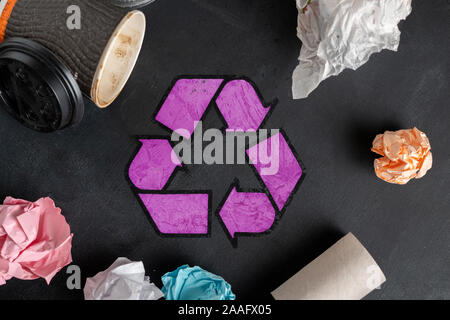 symbol or icon of recycling, top view flat lay with some garbage s - Stock Photo