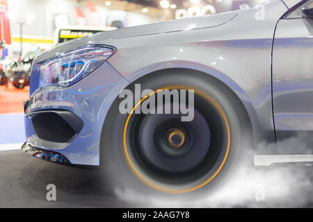 Car wheel on street drifting and smoking on track dark edition. Drifting show. - Stock Photo