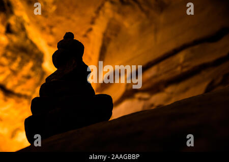 Cairn silhouette in slot canyon in the Utah Arizona desert near Moab, Canyonlands, Arches, Zion National Parks - Stock Photo