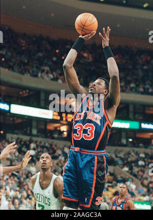 New York Knicks #33 Patrick Ewing shoots the ball during basketball game action at the Fleet Center in Boston Ma USA Feb26,1999 photo by bill belknap - Stock Photo
