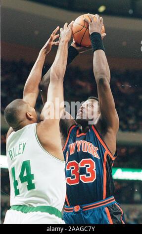 New York Knicks #33 Patrick Ewing shoots on Boston Celtics #44 Eric Riley during basketball game action at the Fleet Center in Boston Ma USA Feb26,1999 photo by bill belknap - Stock Photo
