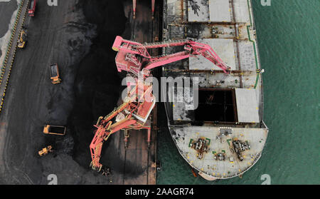 Rizhao. 21st Nov, 2019. Aerial photo taken on Nov. 21, 2019 shows a cargo ship being loaded up with coal at Rizhao Port in Rizhao, east China's Shandong Province. Credit: Wang Kai/Xinhua/Alamy Live News - Stock Photo