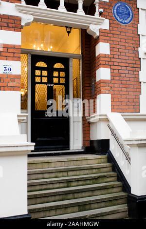 English Heritage blue plaque marking Sir Edwin Arnold's house in Bolton Gardens, Kensington, London - Stock Photo