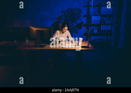 Nice attractive stylish focused lonely single lady hardworking top executive manager analyst marketer financier analyzing data preparing report alone - Stock Photo