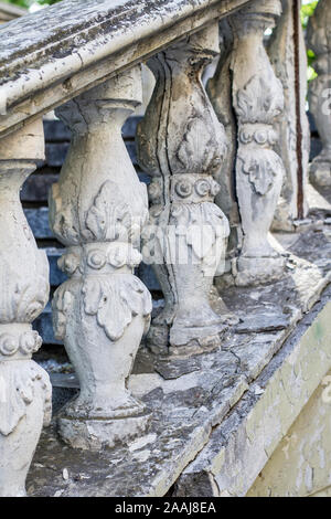 Columns on the old staircase. Railing on the stairs - Stock Photo
