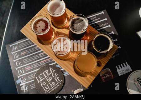 A Flight of beers selection at Letraria Craft Beer Garden in Porto Portugal. - Stock Photo