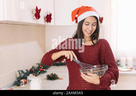 Close-up of woman whisking eggs in bowl - Stock Photo