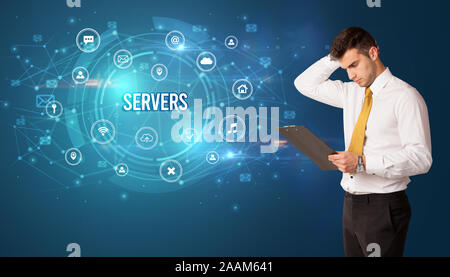Businessman thinking in front of technology related icons and SERVERS inscription, modern technology concept - Stock Photo