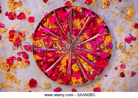 Traditionally decorated Henna or  mehendi plate decorated with rose flowers on the occasion of an Indian wedding - Stock Photo