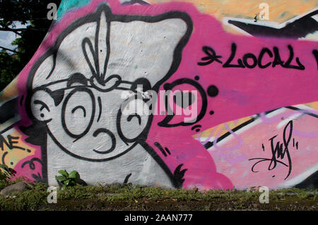 Ubud, Bali, Indonesia - 17th May 2019 : Beautiful colored mural showing a balinese figure with traditional head wear with the inscription local. - Stock Photo