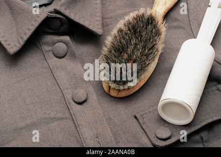 Clothes cleaning concept. Clean roller and brush close up. - Stock Photo