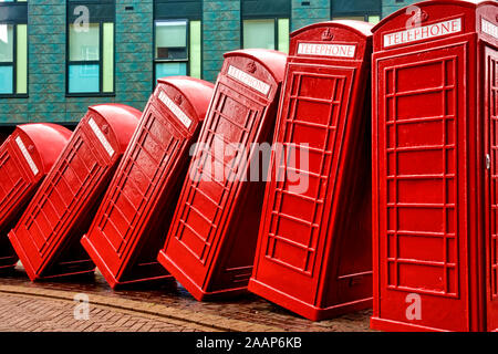Kingston Upon Thames, Surrey / UK - May 08 2019: David Mach's famous 12 toppling telephone boxes art installation 'Out of Order' in Old London Road - Stock Photo