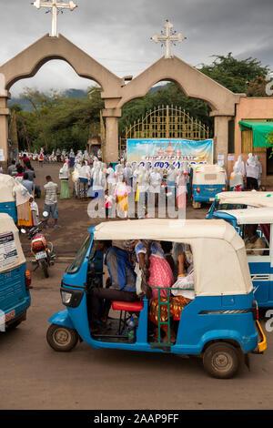 Ethiopia, Gamo-Gofa, Arba Minch, St Gebriel Orthodox Church, worshippers arriving by Bajaj tuk-tuk - Stock Photo