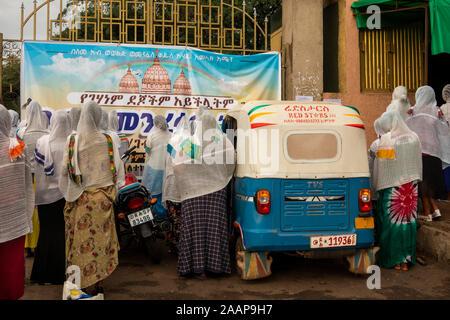 Ethiopia, Gamo-Gofa, Arba Minch, St Gebriel Orthodox Church, worshippers outside church wall - Stock Photo