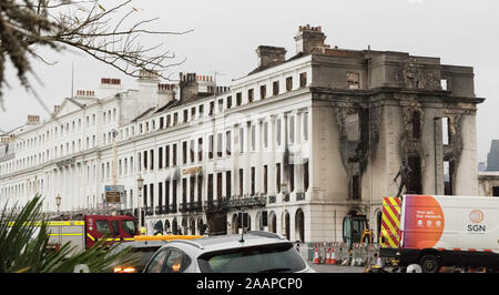 Eastbourne, UK. 23rd November, 2019.  East Sussex Fire and Rescue Service remain at the scene of yesterdays devastating fire which gutted  the Claremont Hotel, Eastbourne. The seafront including the towns famous pier, itself severely damaged by fire in 2014 remain closed to traffic and pedestrians whilst the clearing up operation continues. Credit: Alan Fraser/Alamy Live News - Stock Photo