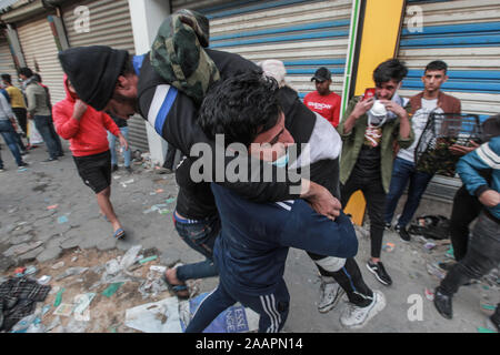 Baghdad, Iraq. 23rd Nov, 2019. A man carroes an injured Iraqi protester during a violent anti-government protest. Credit: Ameer Al Mohammedaw/dpa Credit: dpa picture alliance/Alamy Live News/dpa/Alamy Live News - Stock Photo