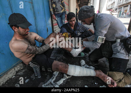 Baghdad, Iraq. 23rd Nov, 2019. An Iraqi protester gets first aid during a violent anti-government protest. Credit: Ameer Al Mohammedaw/dpa Credit: dpa picture alliance/Alamy Live News/dpa/Alamy Live News - Stock Photo
