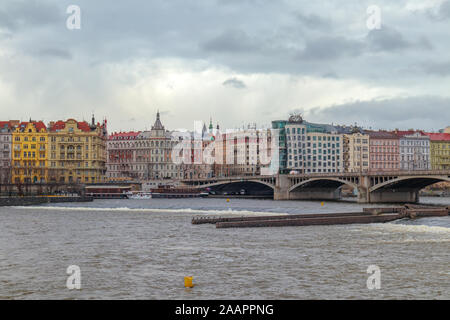 Wide view from one side of the river into prague facade in a overcast day Stock Photo
