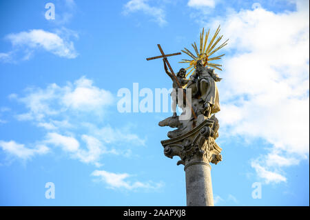'Morovy stlp' (The Plague Column) from 1713 commemorating the end of the plague epidemic. The baroque column depicting the Holy Trinity. - Stock Photo