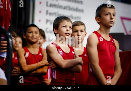 Cottbus, Germany. 23rd Nov, 2019. Gymnastics: World Cup, 44th International Tournament of Champions, Men's Final: Runners are waiting for their performance in the gymnasium. Credit: Monika Skolimowska/dpa-Zentralbild/dpa/Alamy Live News - Stock Photo