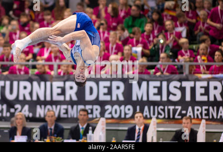 Cottbus, Germany. 23rd Nov, 2019. Gymnastics: World Cup, 44th International Champions' Tournament, Men's Final: Gymnast Colin van Wicklen from the USA is doing gymnastics on the ground. Credit: Monika Skolimowska/dpa-Zentralbild/dpa/Alamy Live News - Stock Photo