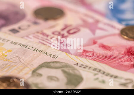 A composition of Turkish lira TL. TRY banknotes and coins providing great options to be used for illustrating subjects as business, banking, media, pr - Stock Photo