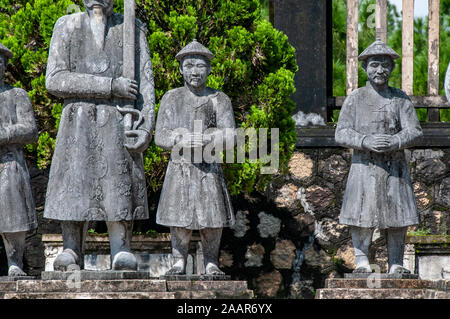 Stone warriors placed on parade to guard the tomb of Emperor Khai Dinh in Hue. - Stock Photo