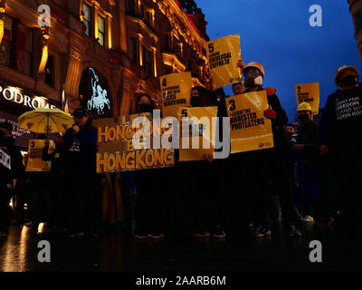 London, UK. 23rd November. Supporters of the protests in Hong Kong demanding democracy and freedom seen on a demonstration in the West End of London, UK. Credit: Joe Kuis / Alamy News - Stock Photo