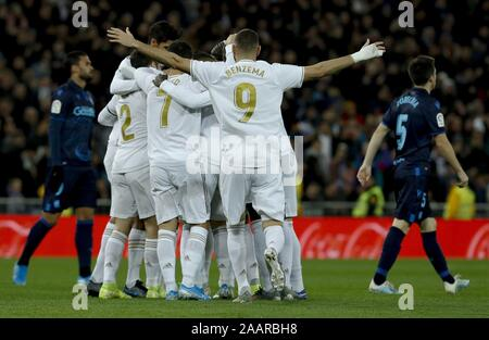 Madrid, Spain. 23rd Nov, 2019. Real Madrid's players celebrate the 2-1 during the Spanish LaLiga soccer match between Real Madrid and Real Sociedad at Santiago Bernabeu stadium in Madrid, Spain, 23 November 2019. Credit: Ballesteros/EFE/Alamy Live News - Stock Photo